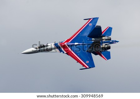 "Samara, Russia - August 22. 2015: Demonstration performances of flight group ""Falcons of Russia"" on Su-27. Airshow devoted to the celebration of the National Flag of the Russian Federation"