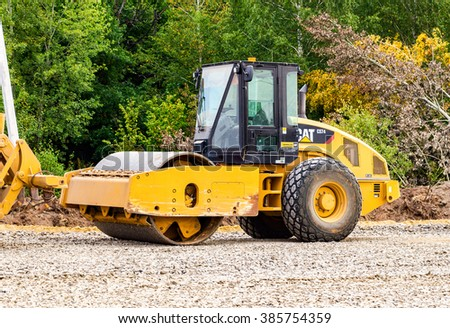 SAMARA, RUSSIA - AUGUST 26, 2015: Heavy bulldozer loading and moving gravel on road construction site - stock photo