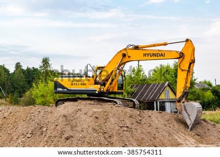 SAMARA, RUSSIA - AUGUST 26, 2015: Hyundai excavator at construction site in summer sunny day - stock photo