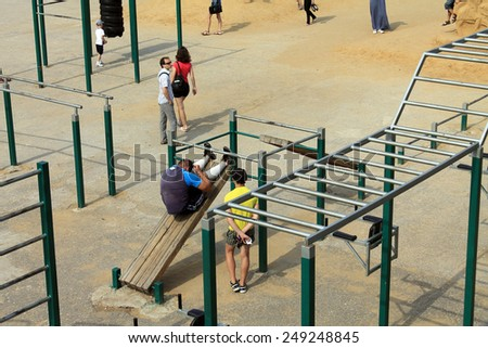 Samara, Russia - August 23, 2014: strangers on the Playground exercise in Samara, Russia - August 23, 2014. - stock photo