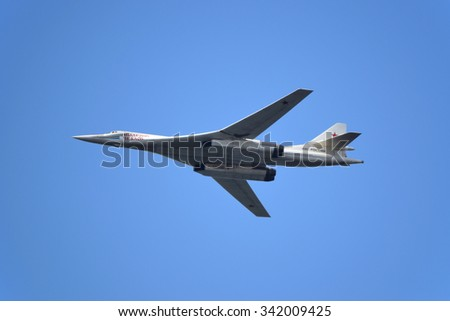 "SAMARA, RUSSIA - AUGUST 22: Tu-160 ""Blackjack"" strategic bomber demonstration performance. Airshow devoted to the celebration of the National Flag of the Russia on August 22, 2015 in Samara, Russia  - stock photo"