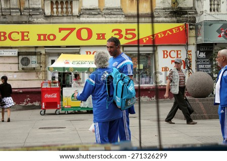 Samara, Russia - August 21, 2014: unknown people in shape are talking on the street in Samara, Russia - August 21, 2014. - stock photo
