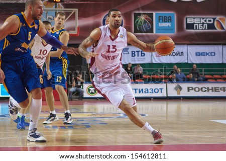 SAMARA, RUSSIA - DECEMBER 17: Chester Simmons of BC Krasnye Krylia, with ball, is on the attack during a BC Khimki game on December 17, 2012 in Samara, Russia. - stock photo
