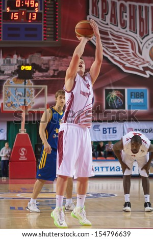 SAMARA, RUSSIA - DECEMBER 17: Dmitry Kulagin of BC Krasnye Krylia throws from the free throw line in a game against BC Khimki on December 17, 2012 in Samara, Russia. - stock photo
