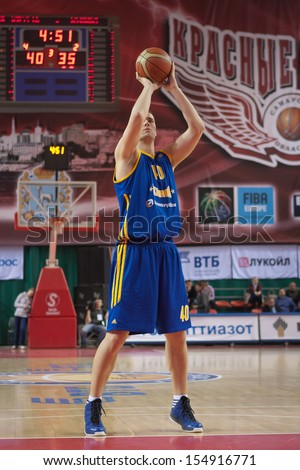 SAMARA, RUSSIA - DECEMBER 17: Paul Davis of BC Khimki throws from the free throw line in a game against BC Krasnye Krylia on December 17, 2012 in Samara, Russia. - stock photo