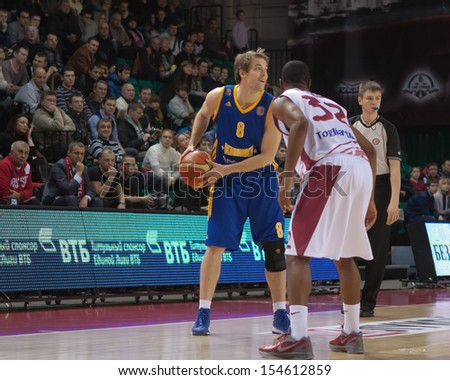 SAMARA, RUSSIA - DECEMBER 17: Petteri Koponen of BC Khimki, with ball, is on the attack during a BC Krasnye Krylia game on December 17, 2012 in Samara, Russia. - stock photo
