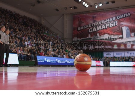 SAMARA, RUSSIA - DECEMBER 02: The ball is on the basketball court during a game between BC Krasnye Krylia and BC UNICS on December 02, 2012 in Samara, Russia. - stock photo