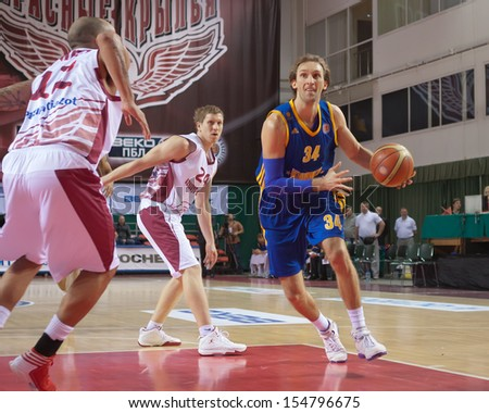 SAMARA, RUSSIA - DECEMBER 17: Zoran Planinic of BC Khimki, with ball, is on the attack during a BC Krasnye Krylia game on December 17, 2012 in Samara, Russia. - stock photo