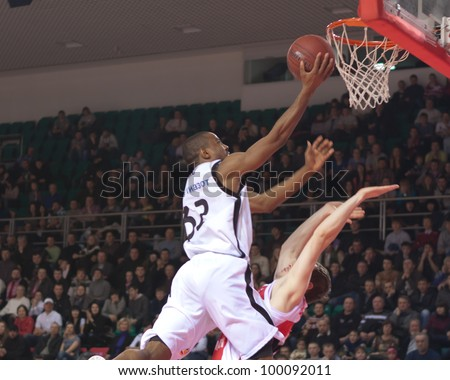 SAMARA, RUSSIA - FEBRUARY 18: Aaron Marquez Miles of BC Krasnye Krylia throws a ball in a basket during a BC Spartak-Primorye game on February 18, 2012 in Samara, Russia. - stock photo