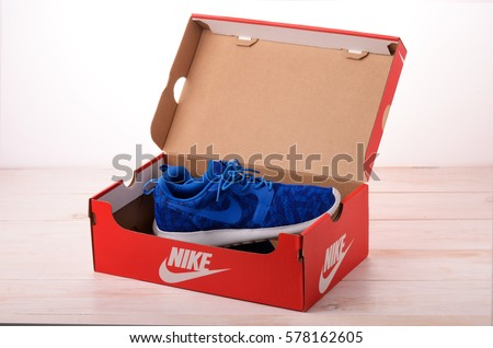 SAMARA, RUSSIA - February 11, 2017: Blue Nike sneakers for running in red box, football, training, showing the Nike logo, illustrative editorial