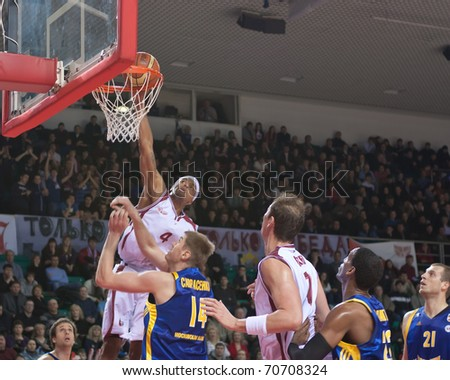 SAMARA, RUSSIA - FEBRUARY 06: Brion Rush of BC Krasnye Krylia makes a slam dunk on February 06, 2011 in Samara, Russia.