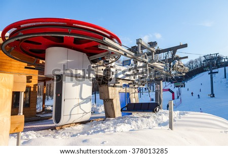 "SAMARA, RUSSIA - FEBRUARY 14, 2016: Chairlift in ""Krasnaya Glinka"" mountain ski resort in winter sunny day in Samara, Russia"