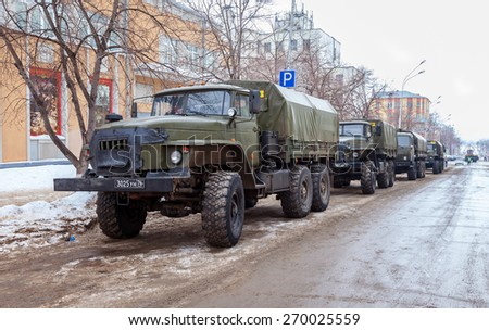 SAMARA, RUSSIA - FEBRUARY 22, 2015: Green russian military truck URAL 4320 worth in the row on a city street - stock photo