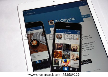Samara, Russia - February 17, 2015: Instagram app open in the mobile phone Iphone 5s and ipad air2. Apple Corporation main direction rapidly developing market of smartphones. - stock photo
