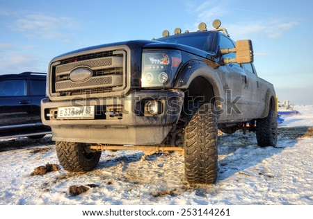 SAMARA, RUSSIA - FEBRUARY 14, 2015: Off-road 4x4 car Ford on the road in the wintertime close-up - stock photo