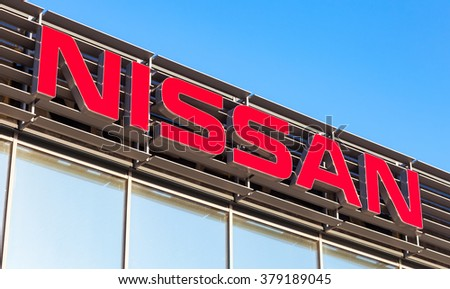 SAMARA, RUSSIA - FEBRUARY 13, 2016: Official dealership sign of Nissan against blue sky. Nissan is a Japanese multinational automaker