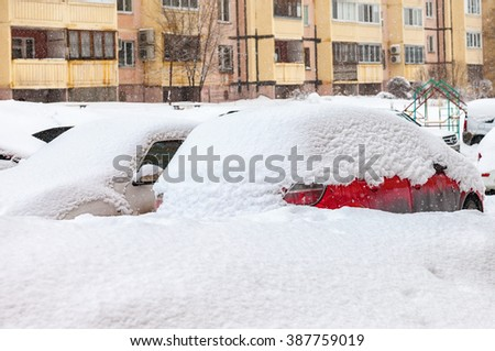 SAMARA, RUSSIA - FEBRUARY 28, 2016: Vehicles covered with snow in the winter blizzard in the parking lot