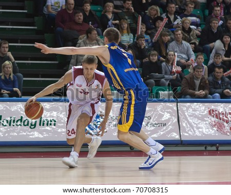 SAMARA, RUSSIA - FEBRUARY 06: Victor Zvarykin, of BC Krasnye Krylia, drives past a BC Khimki player on February 06, 2011 in Samara, Russia.