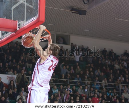 SAMARA, RUSSIA - FEBRUARY 25: Victor Zvarykin of BC Krasnye Krylia makes slam dunk to BC Spartak on February 25, 2011 in Samara, Russia. - stock photo