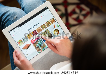 Samara, Russia - January 08, 2015: Close up of pinterest website on a ipad screen. pinterest announces a new application for mobile devices. Food and drink page - stock photo
