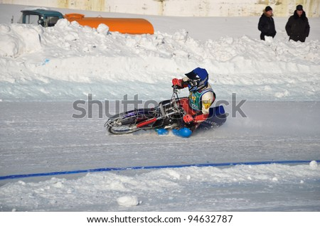 SAMARA, RUSSIA - JANUARY 29: Race the ice speedway on a motorcycle with spikes, the racer N. Ryabokon accelerates after the turn of, Ice Speedway Cup of Russia January 29, 2012 in Samara, Russia