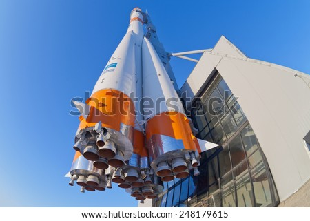 "SAMARA, RUSSIA - JANUARY 26, 2013: Real ""Soyuz"" type rocket as monument. Rocket height together with building - 68 meters, weight - 20 tons. The monument was unveiled in 2001 - stock photo"