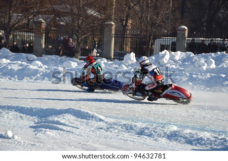 SAMARA, RUSSIA - JANUARY 29: Two rival motorcyclists 11 M. Zelepukin, 5 N. Ryabokon on corner exit icy track, ice speedway Cup of Russia January 29, 2012 in Samara, Russia