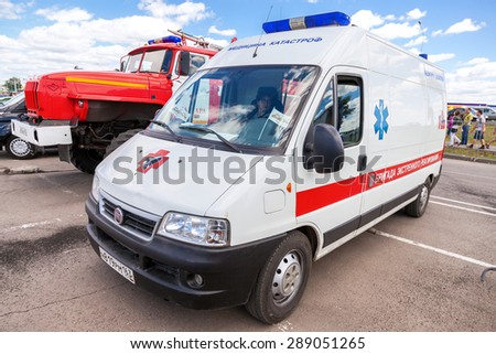 """SAMARA, RUSSIA - JUNE 13, 2015: Ambulance car parked up in the street. Text on russian: """"Team of emergency response"""" - stock photo"""