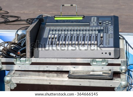 SAMARA, RUSSIA - JUNE 12, 2015: Audio sound mixer with buttons and sliders. Equipment for concerts