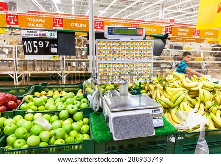 SAMARA, RUSSIA - JUNE 13, 2015: Electronic scales in produce department of the Auchan store - stock photo