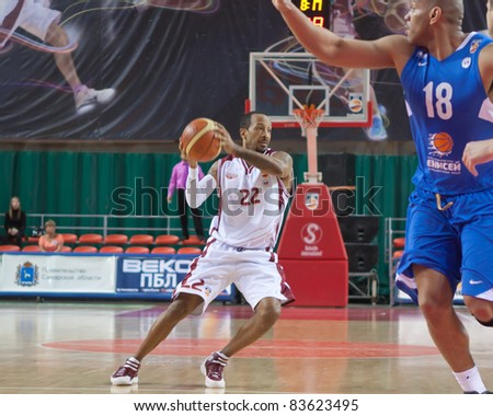 SAMARA, RUSSIA - JUNE 04: Ernest J.R. Bremer of BC Krasnye Krylia, with ball, is on the attack during a BC Enisey game on June 04, 2011 in Samara, Russia.
