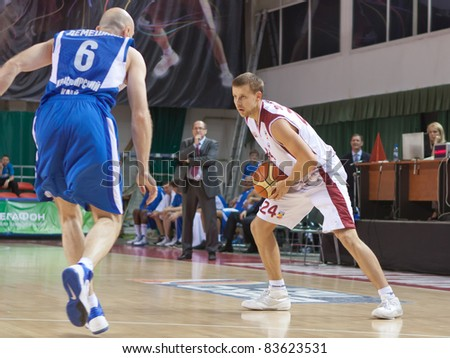 SAMARA, RUSSIA - JUNE 04: Victor Zvarykin of BC Krasnye Krylia, with ball, is on the attack during a BC Enisey game on June 04, 2011 in Samara, Russia.