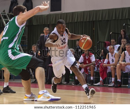 SAMARA, RUSSIA - MARCH 10: Aaron Marquez Miles of BC Krasnye Krylia with ball tries to go past a BC UNICS players on March 10, 2012 in Samara, Russia. - stock photo