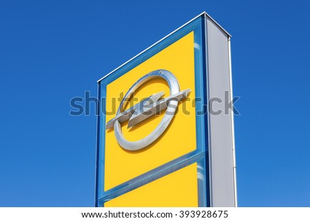 SAMARA, RUSSIA - MARCH 20, 2016: Opel dealership sign against blue sky. Opel is a German automobile manufacturer - stock photo