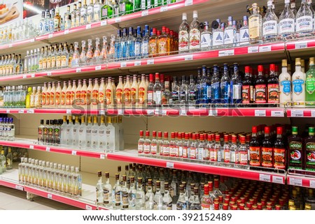 SAMARA, RUSSIA - MARCH 12, 2016: Showcase alcoholic beverages at the hypermarket Magnit. One of largest food retailer in Russia - stock photo