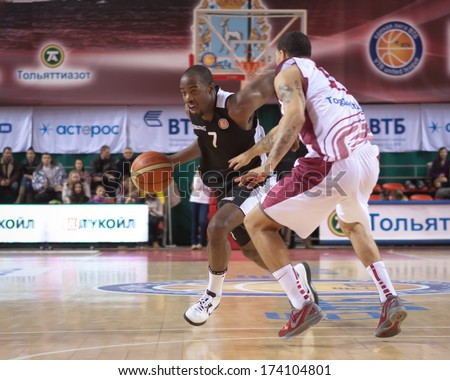 SAMARA, RUSSIA - MARCH 09: Tyshawn Abbott of BC Kalev with ball tries to go past a BC Krasnye Krylia player on March 09, 2013 in Samara, Russia.