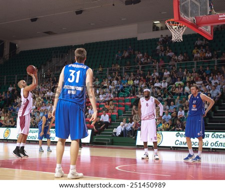 SAMARA, RUSSIA - MAY 11: Andre Smith of BC Krasnye Krylia throws from the free throw line in a BC Enisey game on May 11, 2013 in Samara, Russia. - stock photo