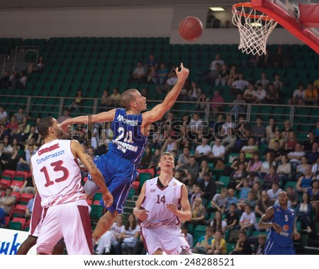 SAMARA, RUSSIA - MAY 11: Andrey Kuzemkin of BC Enisey throws the ball in a basket during a BC Krasnye Krylia game on May 11, 2013 in Samara, Russia. - stock photo