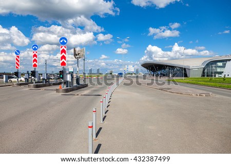 SAMARA, RUSSIA - MAY 22, 2016: Checkpoint by the car parking in the terminal Samara Kurumoch Airport in summer sunny day - stock photo