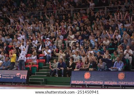 SAMARA, RUSSIA - MAY 19: Fans and spectators enjoyed on tribunes at the game between BC Krasnye Krylia and BC CSKA on May 19, 2013 in Samara, Russia. - stock photo