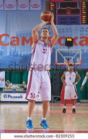 SAMARA, RUSSIA - MAY 11: Fedor Dmitriev of BC Krasnye Krylia throw from the free throw line in a game against BC Enisey on May 11, 2011 in Samara, Russia.