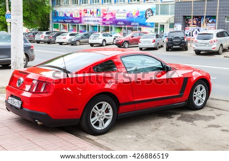 SAMARA, RUSSIA - MAY 21, 2016: Ford Mustang parked up at the city street in summer day. The Ford Mustang is an American automobile manufactured by Ford