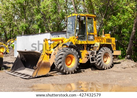SAMARA, RUSSIA - MAY 22, 2016: Heavy loader for construction the road parked near the under construction road