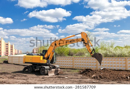 SAMARA, RUSSIA - MAY 11, 2015: Hyundai excavator at construction site in summer sunny day - stock photo