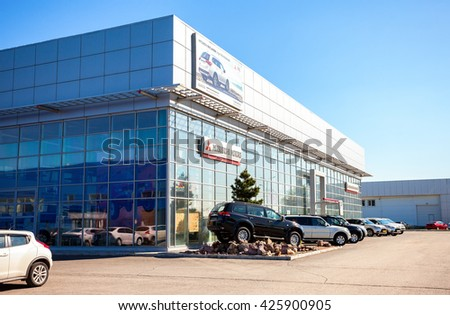 SAMARA, RUSSIA - MAY 14, 2016: New cars parked up near the office of official dealer Mitsubishi. Mitsubishi Motors Corporation is a Japanese multinational automotive manufacturer
