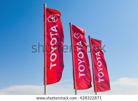 SAMARA, RUSSIA - MAY 29, 2016: Official dealership flags of Toyota against the blue sky background. Toyota Motor Corporation is a Japanese automotive manufacturer - stock photo