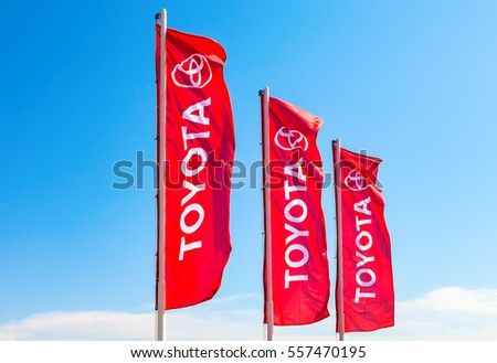 SAMARA, RUSSIA - MAY 29, 2016: Official dealership flags of Toyota against the blue sky. Toyota Motor Corporation is a Japanese automotive manufacturer