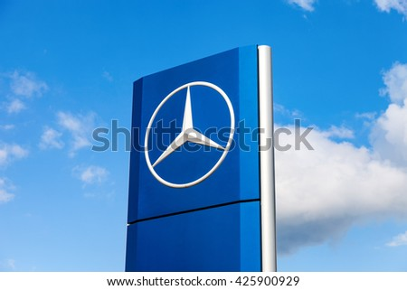 SAMARA, RUSSIA - MAY 22, 2016: Official dealership sign of Mercedes-Benz over blue sky. Mercedes-Benz is a German automotive manufacturer - stock photo