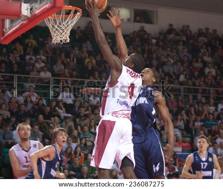 SAMARA, RUSSIA - MAY 03: Omar Thomas of BC Krasnye Krylia throws a ball in a basket during a game against BC Triumph on May 03, 2013 in Samara, Russia. - stock photo