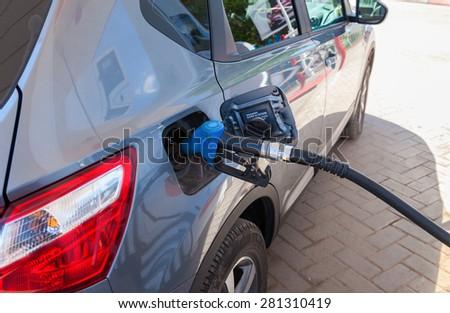 SAMARA, RUSSIA - MAY 23, 2015: Passenger car fueled with petrol at a petrol station - stock photo